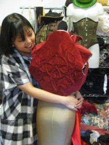 "Sora working on Red Ajah costume forthe film ""Flight from Shadow"""