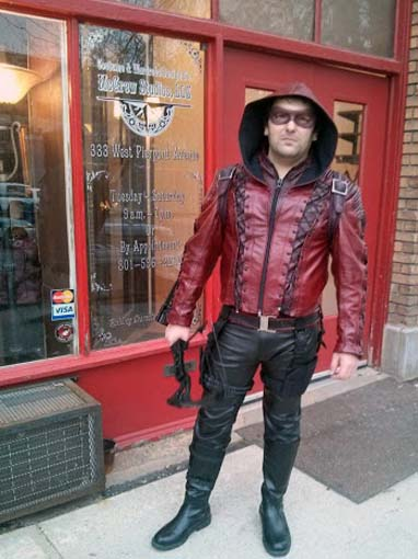 "Custom ""Arsenal"" jacket and quiver. Leathers in two shades of red with grommets and lacing."