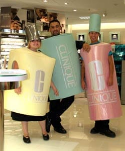 Katrina Kirkland, Naia Folidei and Rory Sepulveda pose in costumes designed as popular Clinique Cosmetics products at the grand opening of the Meier & Frank in Riverdale. The one-story department store is the eighth in Utah to open and is expected to generate between $200,000 and $300,000 in annual sales tax revenue to the city. (Robert Hirschi/The Salt Lake Tribune)