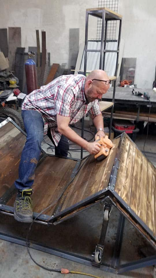 Crit Killen works on custom table for BladeHQ